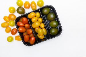 Colorful tomatoes in a tray