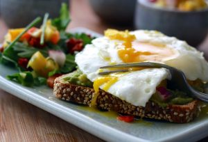 Eggs on toast with salad
